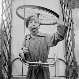 Nigel Henderson: Boy playing with bicycle parts