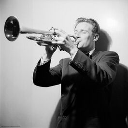 Nigel Henderson: A musician performing on a trumpet