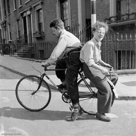 Nigel Henderson: Brian and Leslie Samuels on a bicycle, Bow