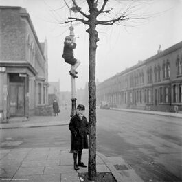Nigel Henderson: Two unidentified children, one of which is climbing a lamp-post