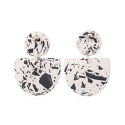Black and white patterned crescent and circle earrings