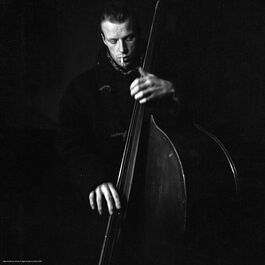 Nigel Henderson: A musician performing on a double bass