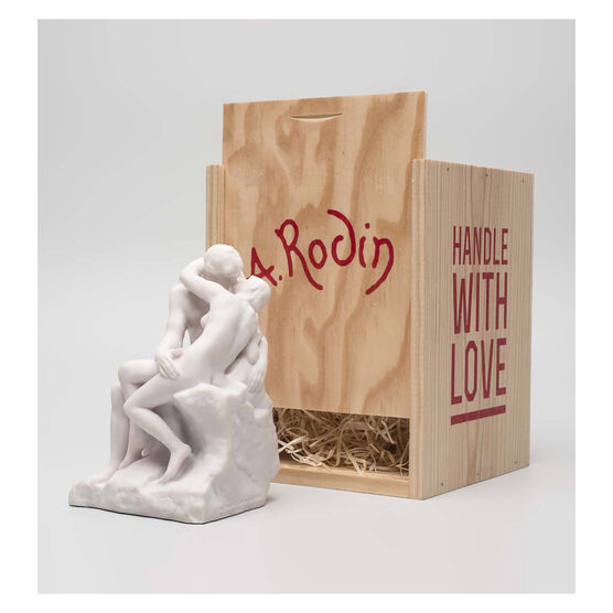 White miniature stature of a couple kissing in a wooden crate