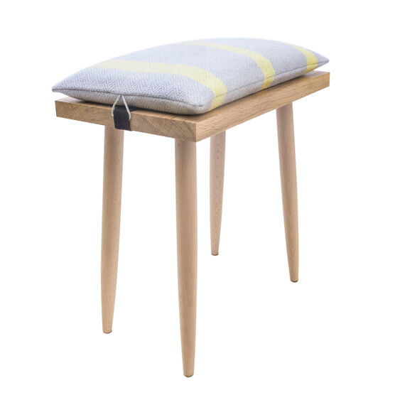 Hearth stool with woven cushion