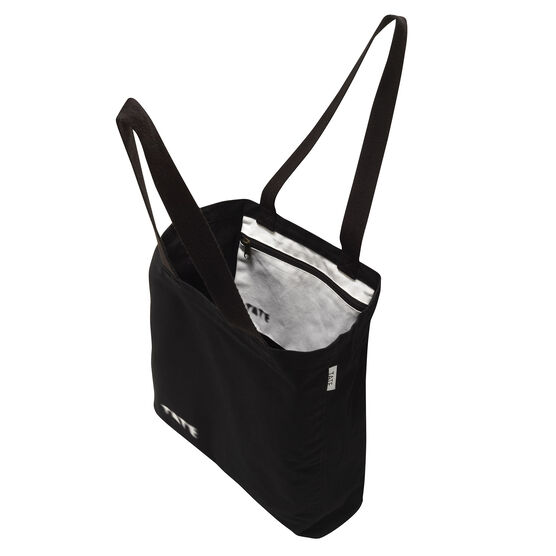 Inside and side view of black tote bag, with Tate logo zip pocket inside.