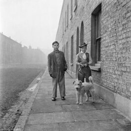 Nigel Henderson: Two unidentified boys with a dog