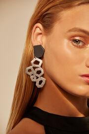 silver leather earrings worn by a model
