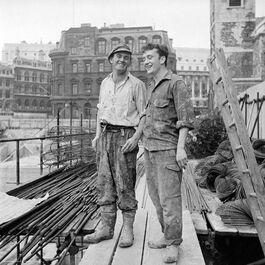 Nigel Henderson: Two construction workers on a construction site