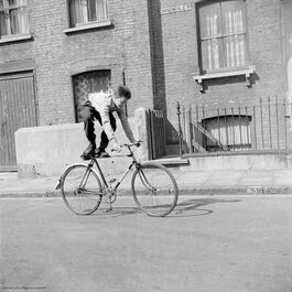 Nigel Henderson: Brian Samuels on a bicycle, Bow