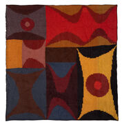 Flat large silk scarf with a print of an embroidered artwork in blues, reds, browns and yellows.