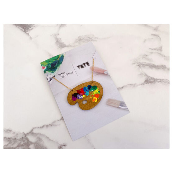 Wooden paint pallete necklace with paint splotches on card