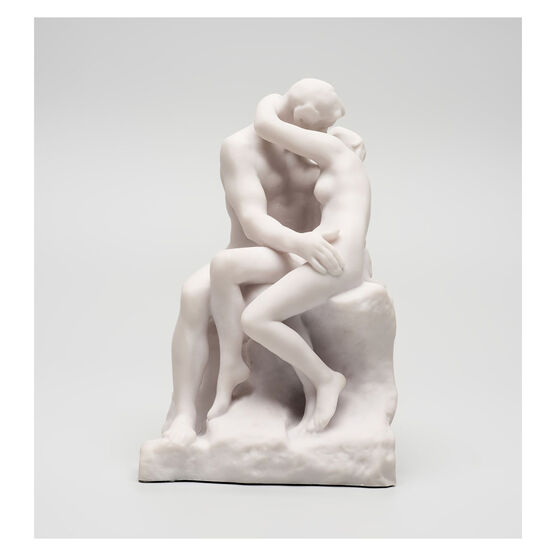 White miniature stature of a couple kissing