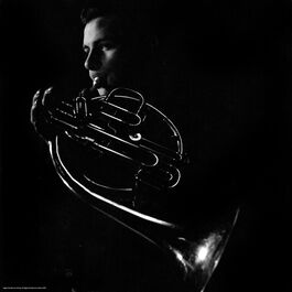 Nigel Henderson: A musician performing on a French horn