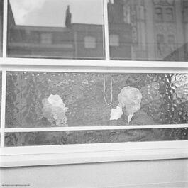 Nigel Henderson: Heads seen through pub window, East End
